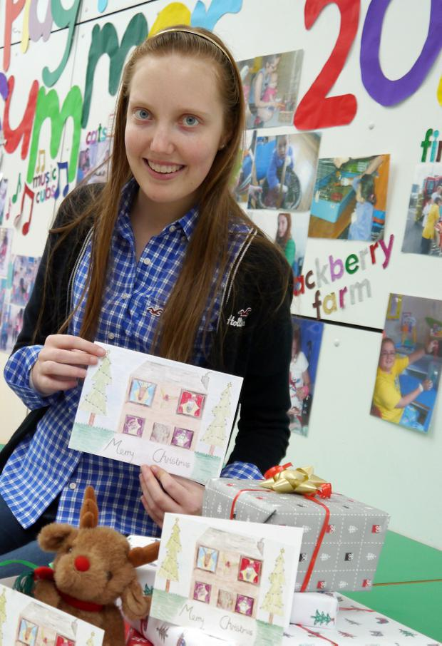 Ava Martin with the Christmas card she designed for the CLIC Sargent appeal
