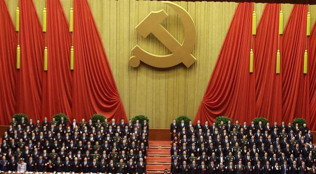 China's top leaders stand at the closing ceremony for the 18th Communist Party Congress at the Great Hall of the People in Beijing (AP)