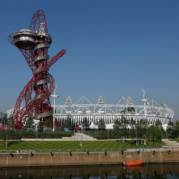 Three people have been charged in connection with allegations regarding information linked to the Olympic Park