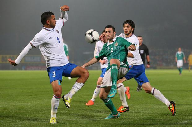 BELFAST, NORTHERN IRELAND - NOVEMBER 14: Daniel Lafferty of Northern Ireland chips the ball past Elhad Naziri of Azerbaijan during the FIFA 2014 World Cup Group F Qualifying match between Northern Ireland and Azerbaijan at Windsor Park on November 14, 2012 in Belfast, Northern Ireland. (Photo by Alex Livesey/Getty Images)