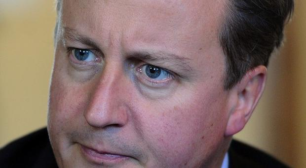David Cameron has been urged by MPs to boycott a summit in Sri Lanka over human rights abuses