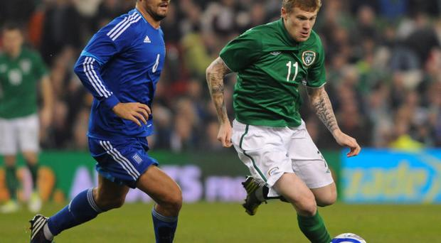 Republic of Ireland's James McClean and Greece Alexandros Tziolis (left) battle for the ball during the International Friendly at the Aviva Stadium, Dublin