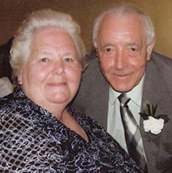 Bertie Acheson, pictured with his wife Sheila, died after confronting an intruder at his home in Coleraine