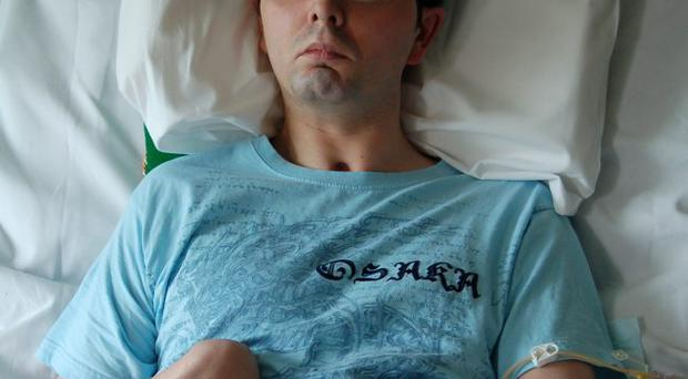 Paul McCauley in his hospital bed