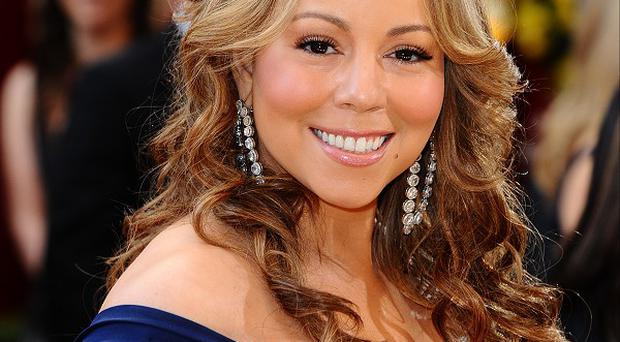 Mariah Carey doesn't like changing nappies, according to husband Nick Cannon