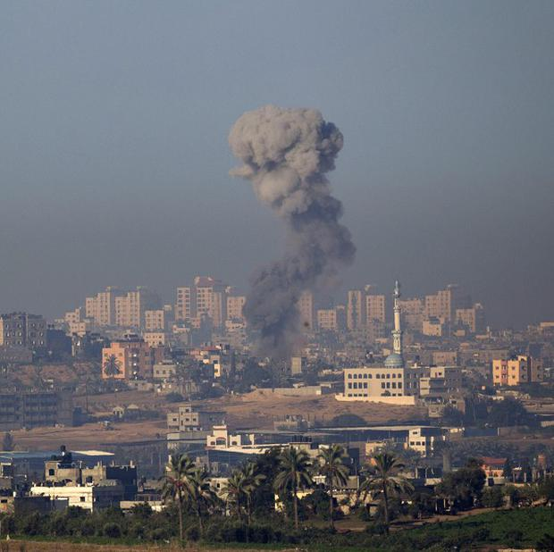 Smoke rises following an Israeli air strike in the northern Gaza Strip amid an increase in violence in the region (AP)
