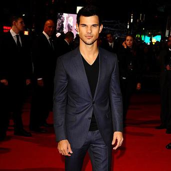 Taylor Lautner wil be happy to keep his shirt on iin future