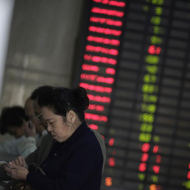 Asian stock markets stayed broadly flat after reports of the eurozone economy contracting