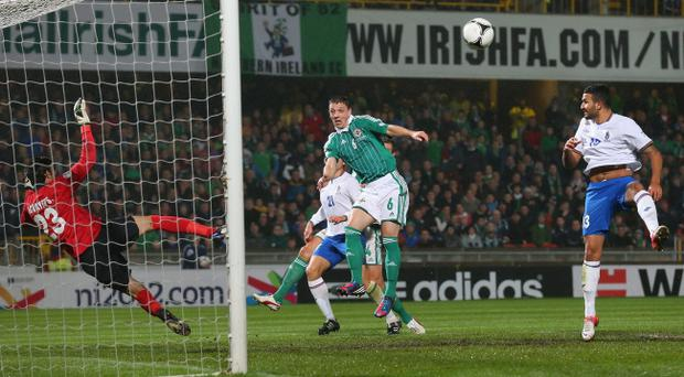 Chris Baird directs a header wide of the post - one of many chances Northern Ireland squandered on Wednesday night