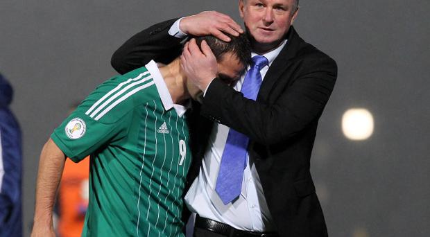 Northern Ireland's goal-scorer David Healy is comforted by manager Michael O'Neill at the end of the game after the team secured a disappointing draw against Azerbaijan in Wednesday night's World Cup 2014 Qualifier at Windsor Park, Belfast