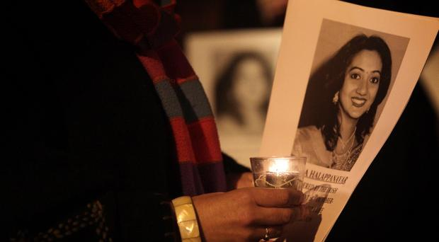 People gathered in Belfast city centre last night in memory of Savita Halappanava who was 17 weeks pregnant, and died at University Hospital Galway last month