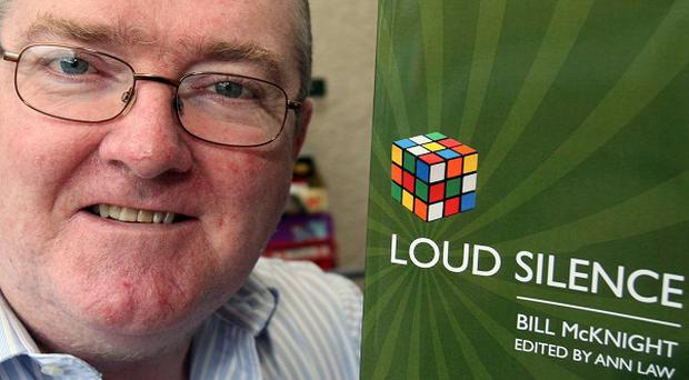 Bill McKnight, with his book of poems Loud Silence