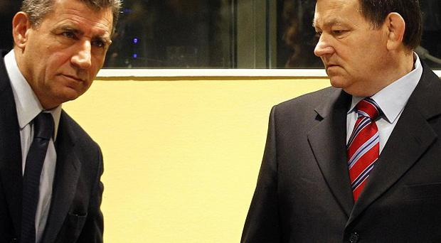Former Croatian generals Ante Gotovina and Mladen Markac have had their war crimes convictions overturned (AP)