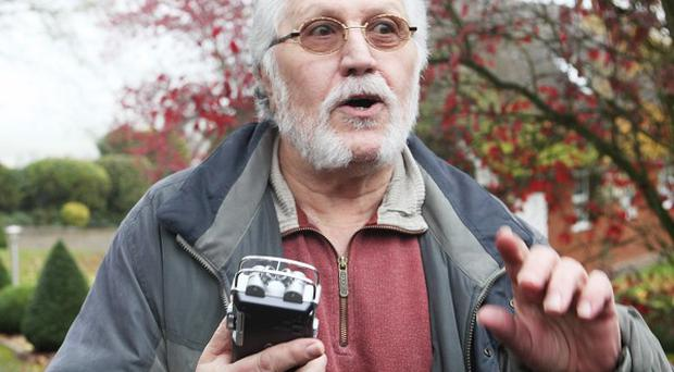 Dave Lee Travis gestures as he records his talks with the media outside his home