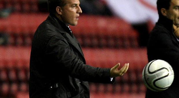 Manager Brendan Rodgers, left, is targeting an improvement in Liverpool's home form