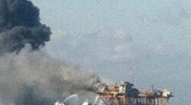 A fire burns on an oil platform after an explosion on the rig, in the Gulf of Mexico off the Louisiana coast (AP)
