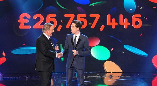 Sir Terry Wogan and Nick Grimshaw reveal the night's final total during BBC Children In Need