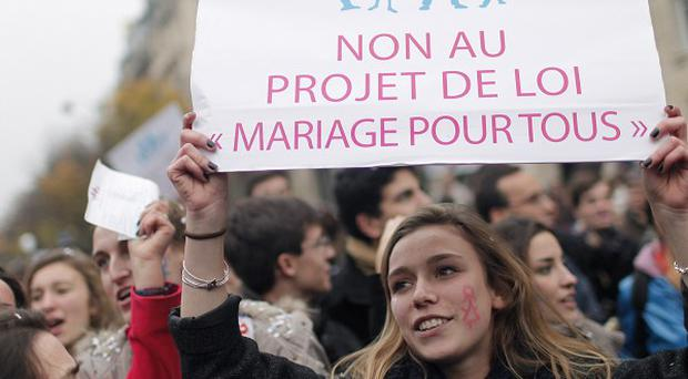 Demonstrators in Paris protest against plans to legalise marriage and adoption for gay people (AP)