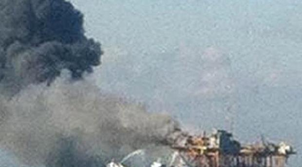 A fire burns on an oil platform in the Gulf of Mexico (AP)