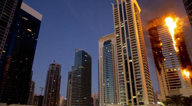 Flames engulf a portion of Tamweel residential tower at Jumeirah Lakes Towers, in Dubai (AP)