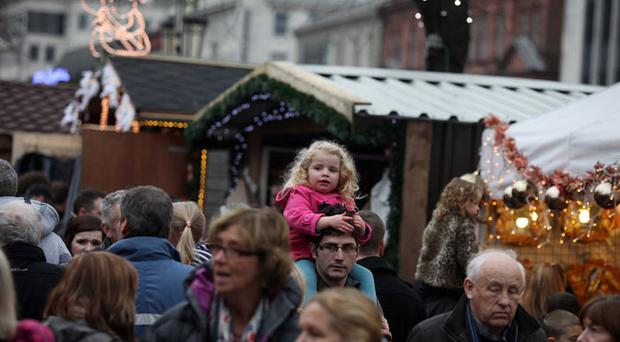 The festive season begins in Belfast with the Christmas market opening in the grounds of Belfast City Hall