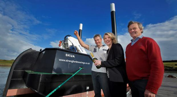 Alison Esler of First Trust Bank, joins Matt Doman (left) and Paul Dorman of Strangford Moorings in launching Skua. The firm's latest vessel has helped to create three new jobs in the company