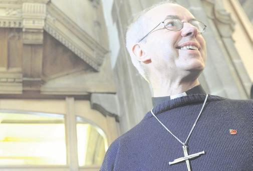 Cross to bear: Dr Justin Welby who has been appointed as the new Archbishop of Canterbury