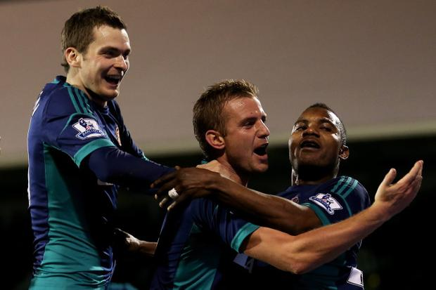 LONDON, ENGLAND - NOVEMBER 18: Stephane Sessegnon (R) of Sunderland celebrates with teammates Adam Johnson (L) and Lee Cattermole (C) after scoring his team's third goal during the Barclays Premier League match between Fulham FC and Sunderland AFC at Craven Cottage on November 18, 2012 in London, England. (Photo by Julian Finney/Getty Images)