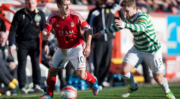 Northern Ireland international Niall McGinn takes on Kris Commons