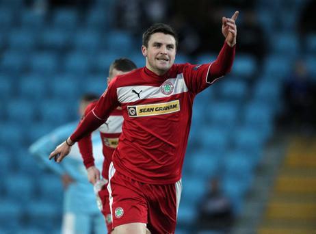Cliftonville's Diarmuid O'Carroll celebrates scoring one of Cliftonville's eight goals against Ballymena United