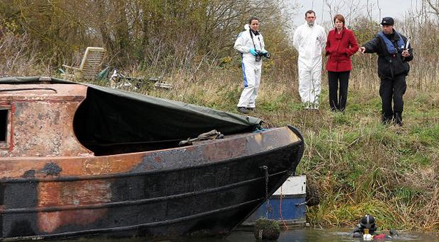 Police investigate a canal boat fire where human bones were found on the boat, near Wolvercote, Oxfordshire