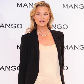 Kate Moss has a tattoo designed by Lucian Freud on her bottom