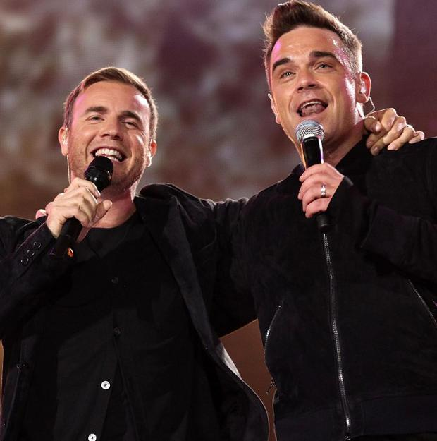 Robbie Williams posted a picture on Twitter of him rehearsing with Gary Barlow