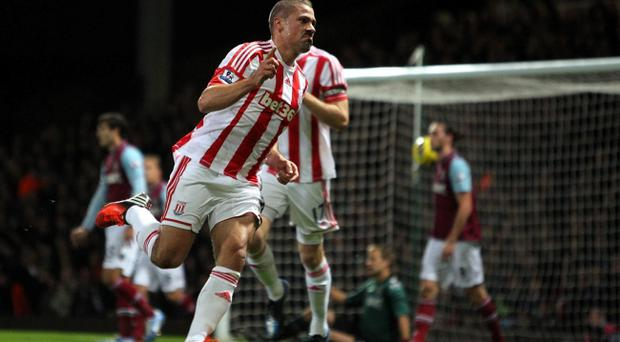 Stoke City's Jonathan Walters celebrates the opening goal during the Barclays Premier League match at Upton Park, London