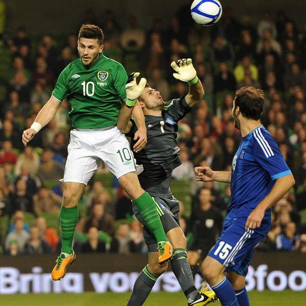 Shane Long, left, started the defeat to Greece