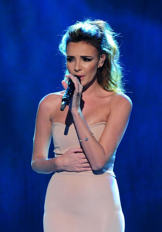 Nadine Coyle of girlband Girls Aloud live on stage during BBC Children In Need, London. PRESS ASSOCIATION Photo. Picture date: Friday November 16, 2012. See PA story SHOWBIZ ChildrenInNeed. Photo credit should read: Ian West/PA Wire