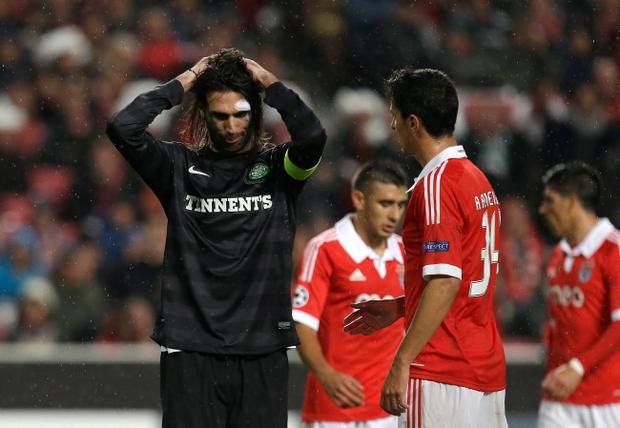 Celtic's Giorgos Samaras, from Greece, left, reacts after a missed chance to score against Benfica during their Champions League group G soccer match Tuesday, Nov. 20 2012, at Benfica's Luz stadium in Lisbon