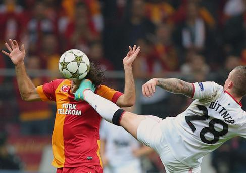 Manchester United's Alexander Buttner, right, and Hamit Altintop of Galatasaray fight for the ball during their Champions League group H soccer match at TT Arena Stadium in Istanbul, Turkey, Tuesday, Nov. 20, 2012. (AP Photo)