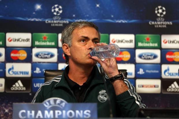 Real Madrid manager Jose Mourinho takes a drink during a press conference at the Etihad Stadium, Manchester
