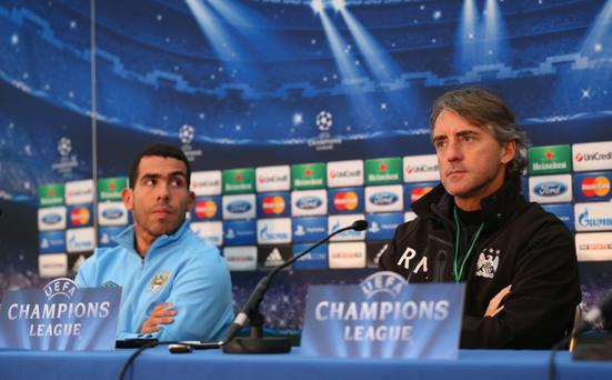 MANCHESTER, ENGLAND - NOVEMBER 20: Carlos Tevez and Roberto Mancini the manager of Manchester City face the media during a press conference at Carrington Training Ground on November 20, 2012 in Manchester, England. (Photo by Alex Livesey/Getty Images)