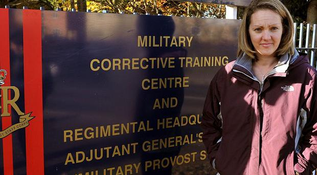 Sally Nightingale stands outside the Military Corrective Training Centre in Colchester, Essex, before seeing her husband Sgt Danny Nightingale