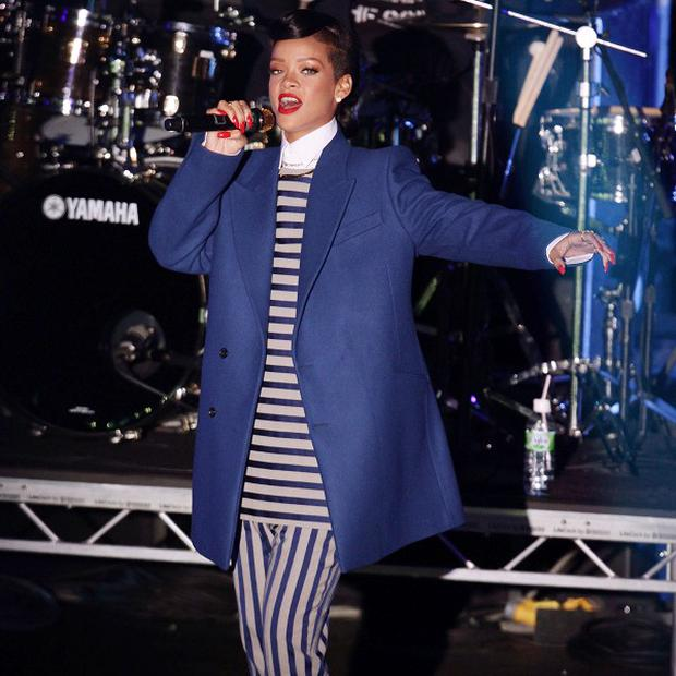 Rihanna performed on stage after switching on the Christmas lights in east London