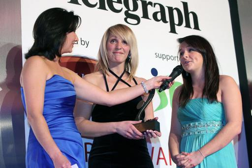 Lurgan College's Julie Hynds and Natalie Barr with Claire McCollum (left) after receiving the Beflast Telegraph Young Team of the Year award