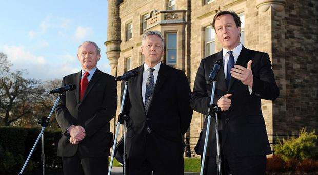 First Minister Peter Robinson and deputy First Minister Martin McGuinness meet with Prime Minister David Cameron at Stormont Castle