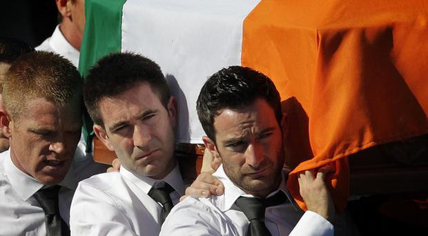 The coffin of Real IRA member Alan Ryan was draped in the Irish flag as it was carried into the Church of the Holy Trinity in Dublin earlier this year