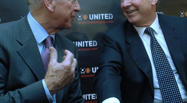 Sir Bobby Charlton, left, is putting no timescale on Sir Alex Ferguson's, right, retirement
