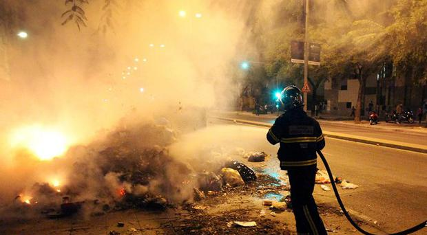 Mounds of burning uncollected rubbish in Jerez (AP)
