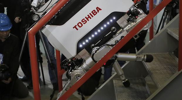 Toshiba's nuclear inspection robot climbs stairs during a demonstration in Yokohama, Japan (AP)