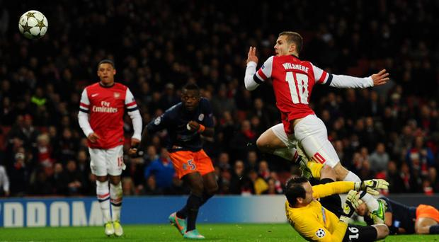 LONDON, ENGLAND - NOVEMBER 21: Jack Wilshere of Arsenal chips goalkeeper Geoffrey Jourdren of Montpellier to score the opening goal during the UEFA Champions League group B match between Arsenal FC and Montpellier Herault SC at Emirates Stadium on November 21, 2012 in London, England. (Photo by Mike Hewitt/Getty Images)