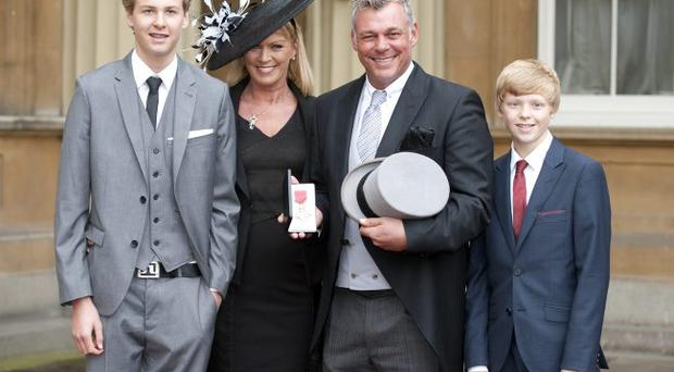 Darren Clarke OBE with wife Alison and sons Tyrone (left) and Conor